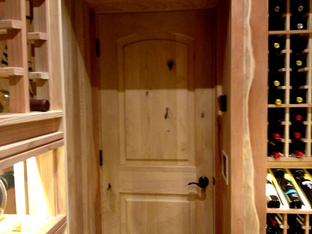 Knotty Alder Wine Cellar Door Installed by a California Master Builder